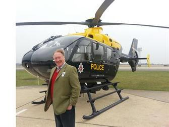 Police & Crime Commissioner next to NPAS helicopter